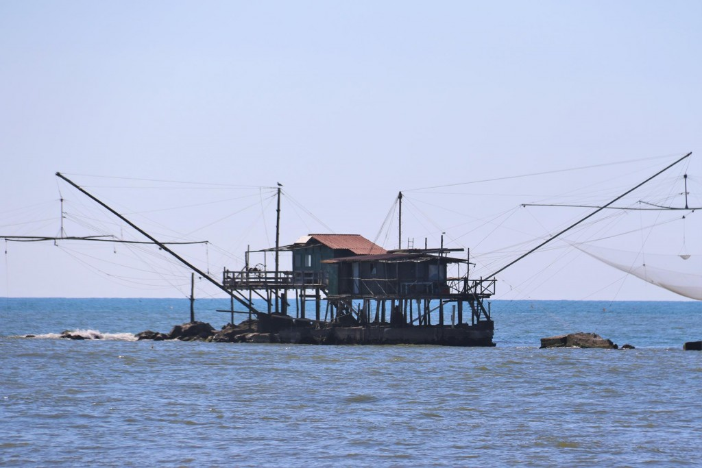 These huge nets are conveniently lowered into the water to catch fish moving between the river and the sea