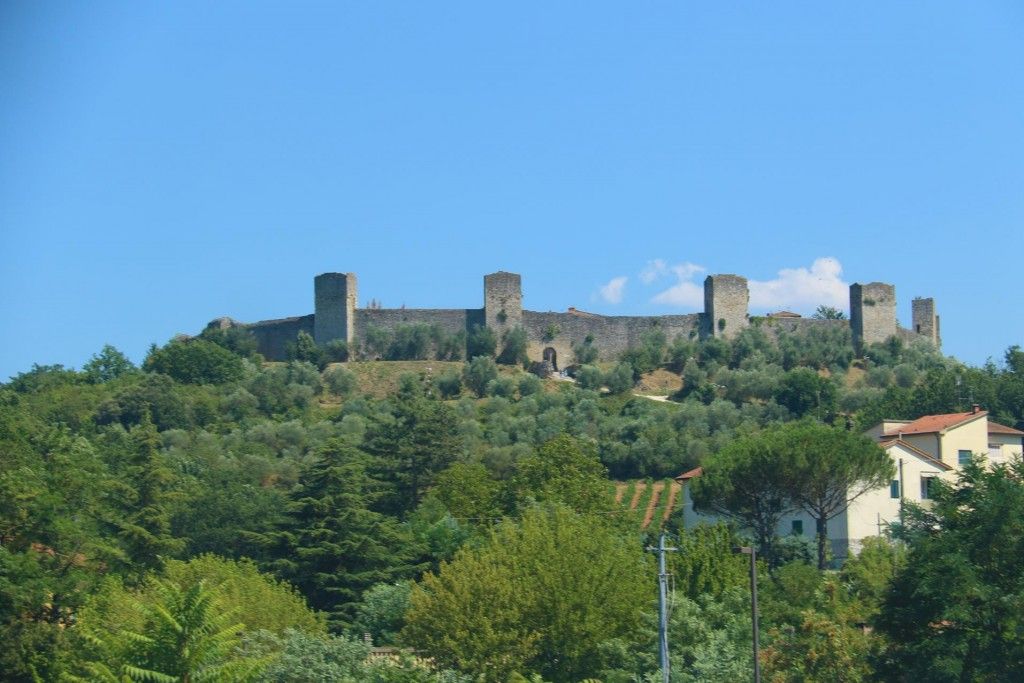 A familiar hilltop medieval town of Monteriggioni, with it's unmistakable circular walls comes into view