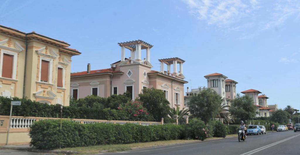 Many smart villas overlooking the coast road on the way