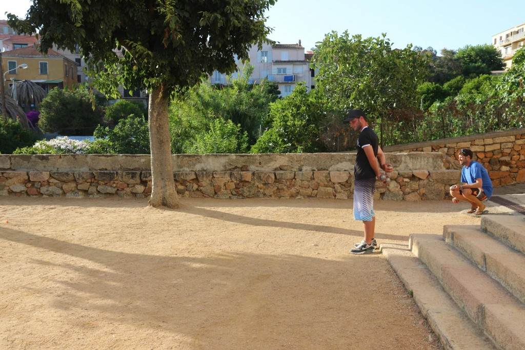 Boules is practised on the terrace infront of the church