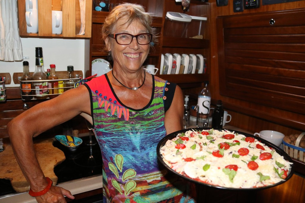 Michele shows us her pizza decoration skills before the pizzas enter the oven!!