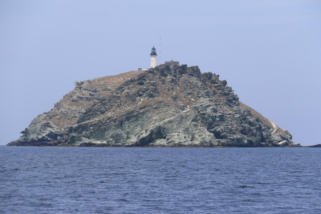 The steep eastern coast of Isola de la Giraglia with it's conspicuous white lighthouse
