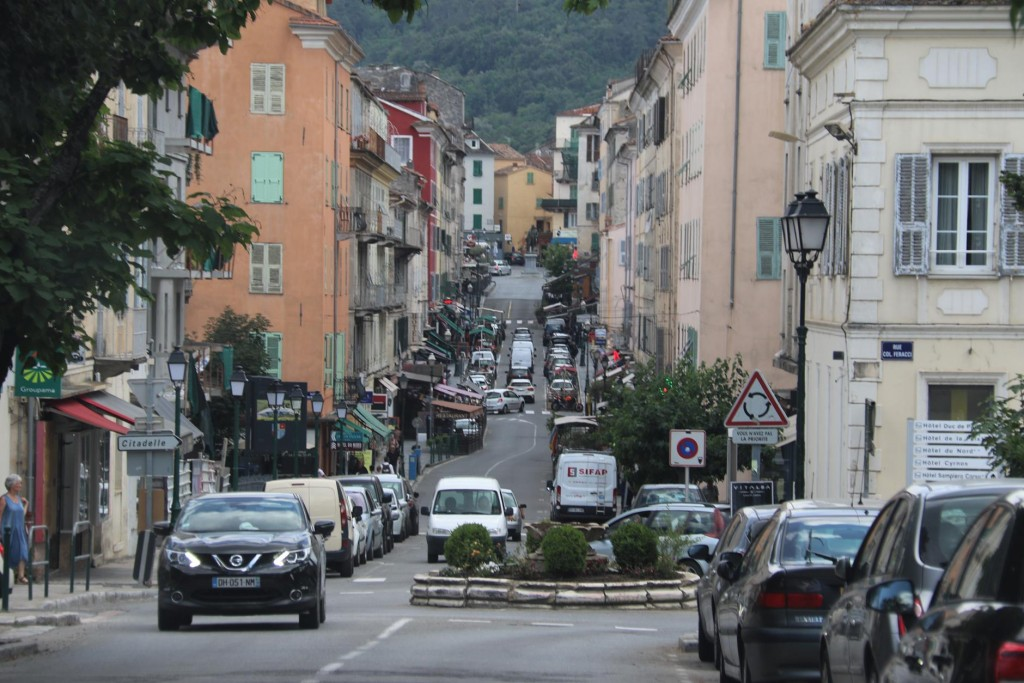 The long main street of Corte which has many cafes, restaurants and shops for the tourists. At the top of the street is a statue of Pascal Paoli a famous leader of Corsica in the late 1700's