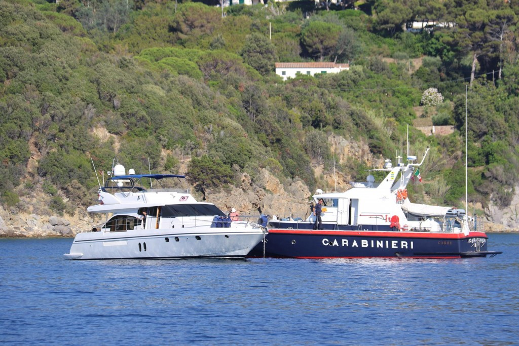 The Carabinieri are checking papers of some boats in the bay!! Not us though!!
