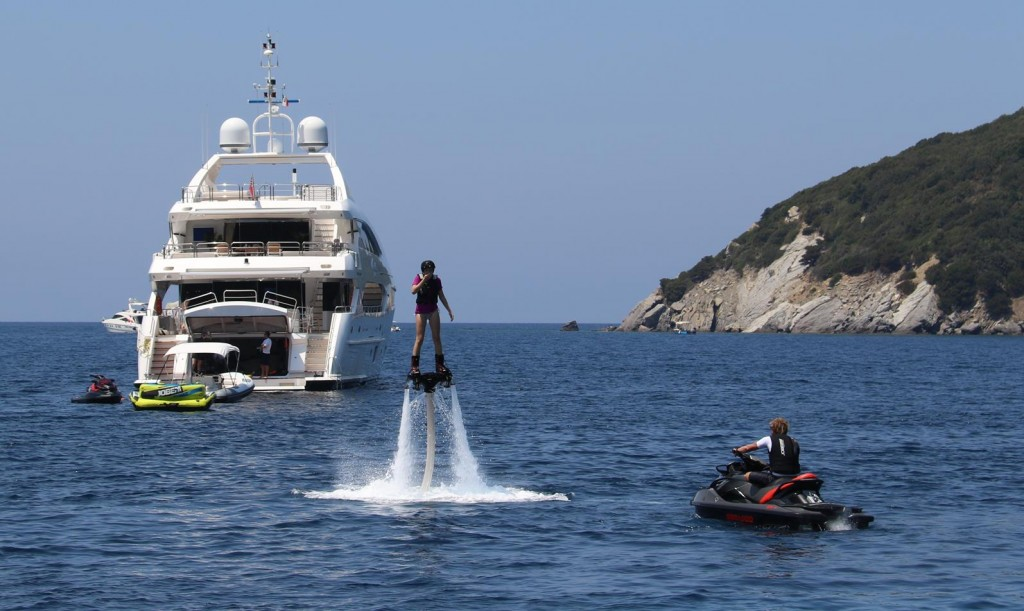 A nearby motor yacht with all their toys