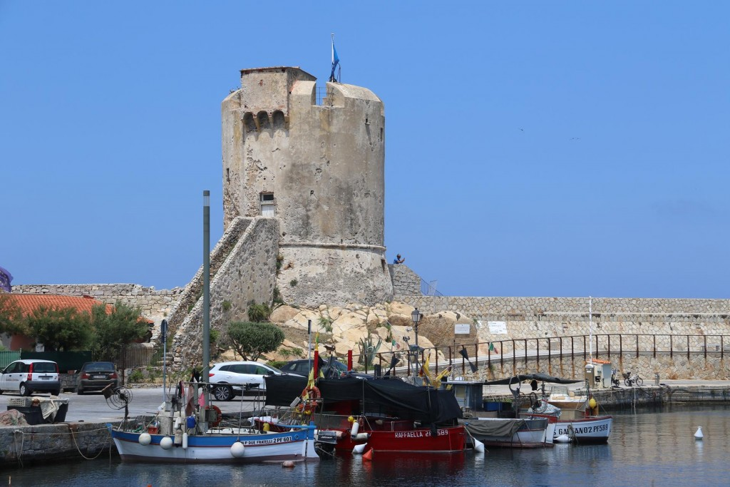 The Genoese tower which stands prominently at the end of the port