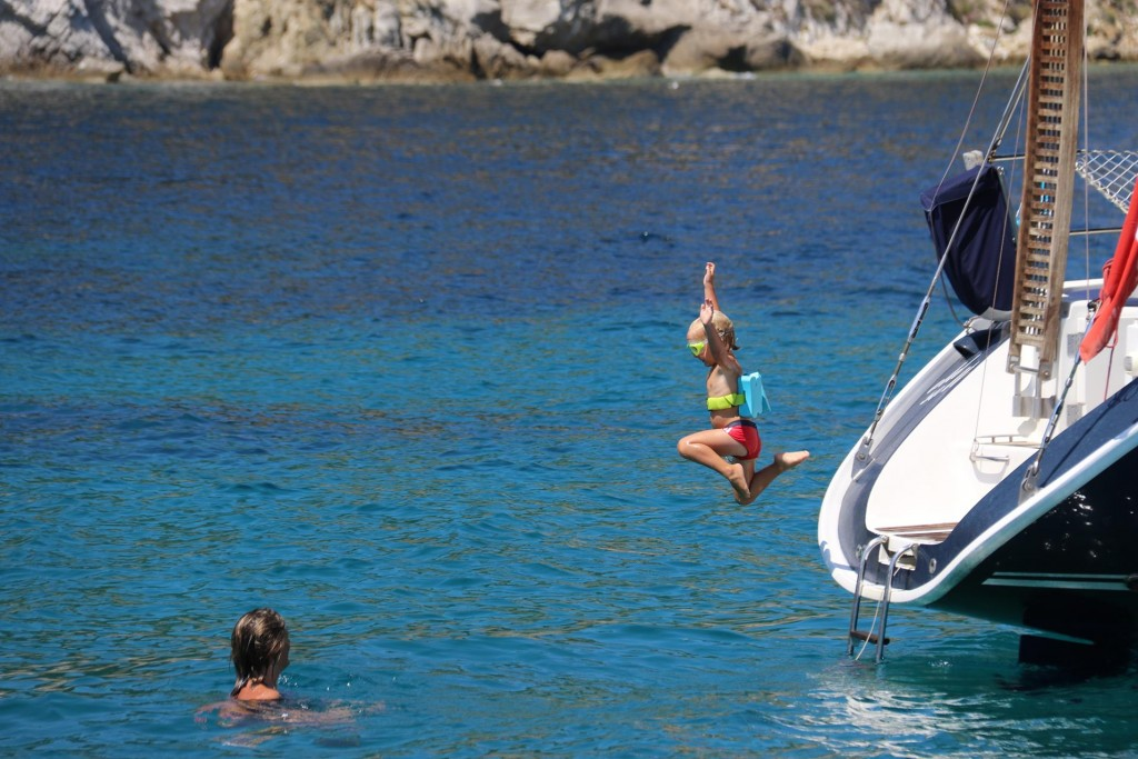 A lively little man at a nearby yacht enjoying the warm clear water!!