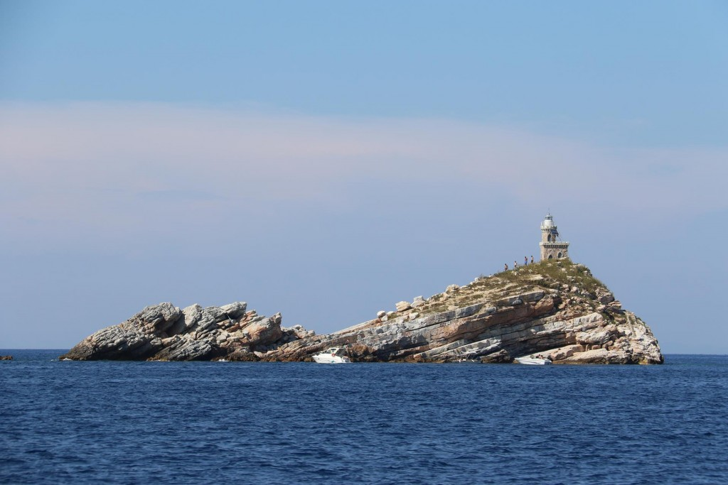 The small rock outcrop of Scoglietti with it's stone lighthouse is just north of Punta Falcone