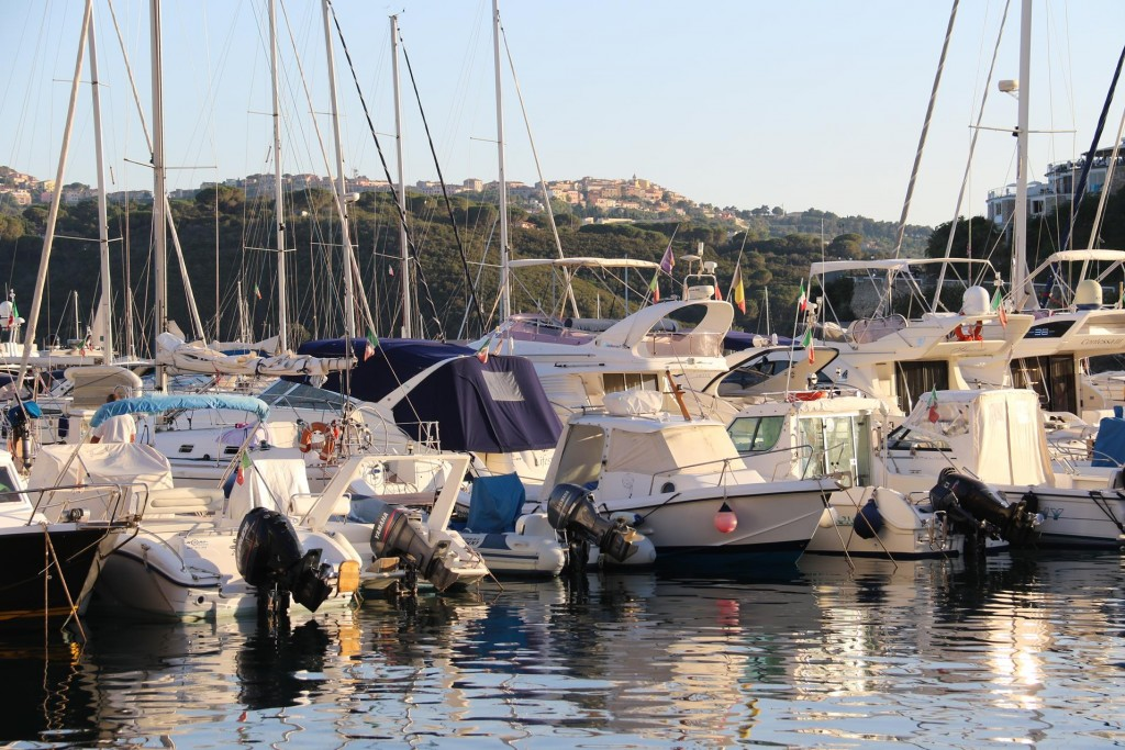 Passing the marina with the old hilltop town of Capoliveri in the background