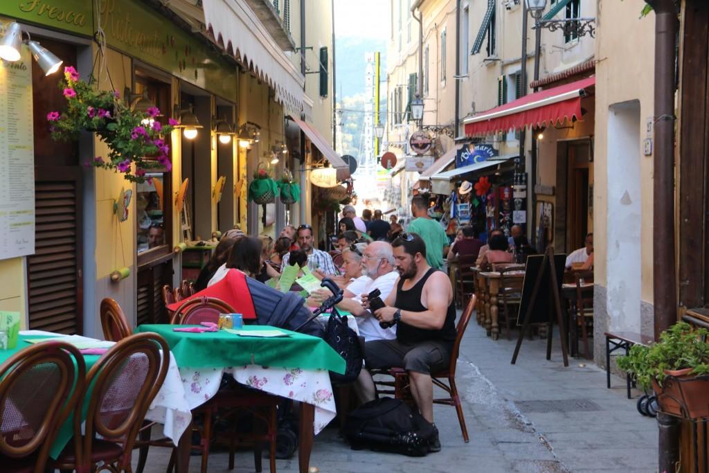 Wall to wall restaurants along the alleyways of Azzurro
