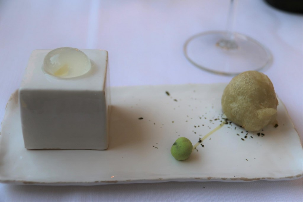An amazing complimentary starter arrives which comprised of a margarita filled gel sphere which was eaten by raising the cube to the mouth!! This was served with a fish cake and a wasabi pea