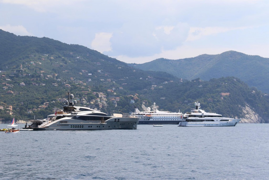 Just outside the harbour of Santa Margaherita a cluster of superyachts are anchored