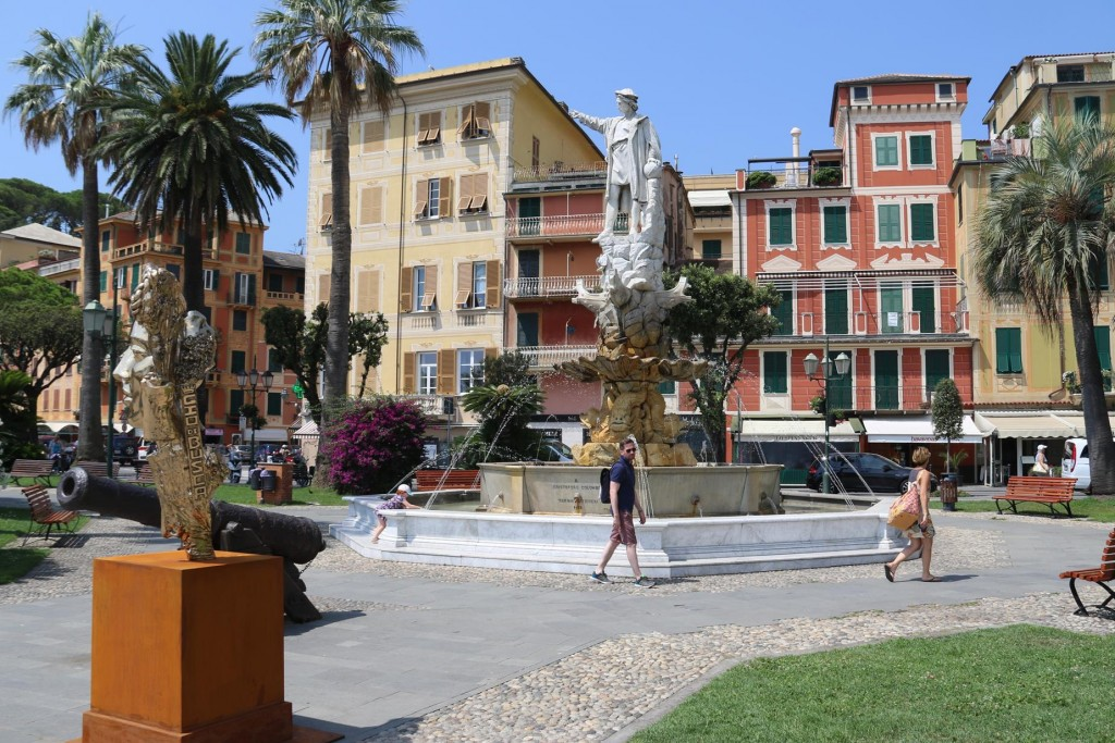 A marble statue of Christopher Colombus adorns a fountain in Santa Margherita overlooking the sea dated 1892