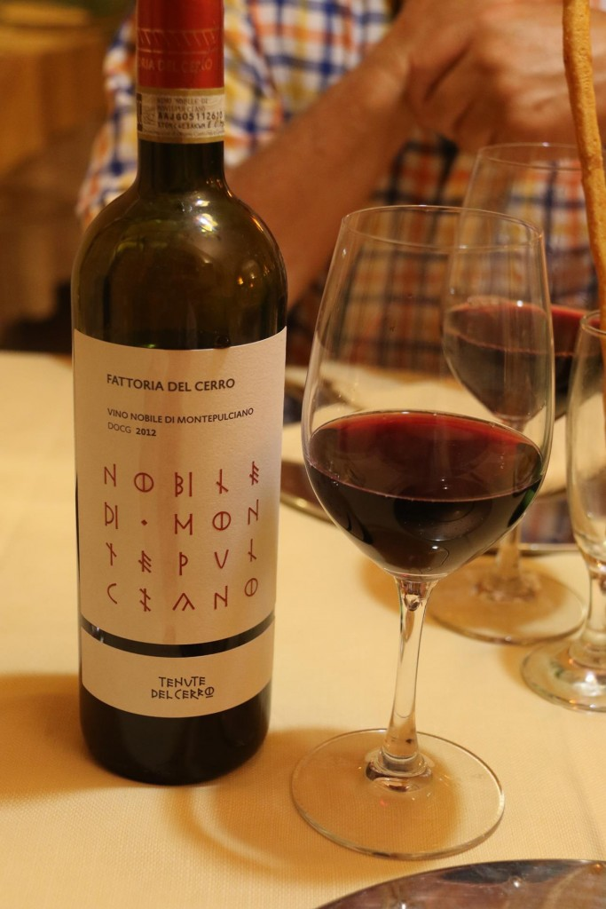 Once seated Ric orders a Montepulciano vino rosso