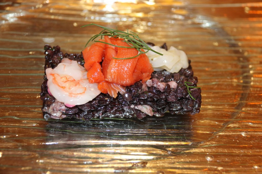 Our first dish of the 6 course degustation menu arrives -Caparccio  of seafood with black rice