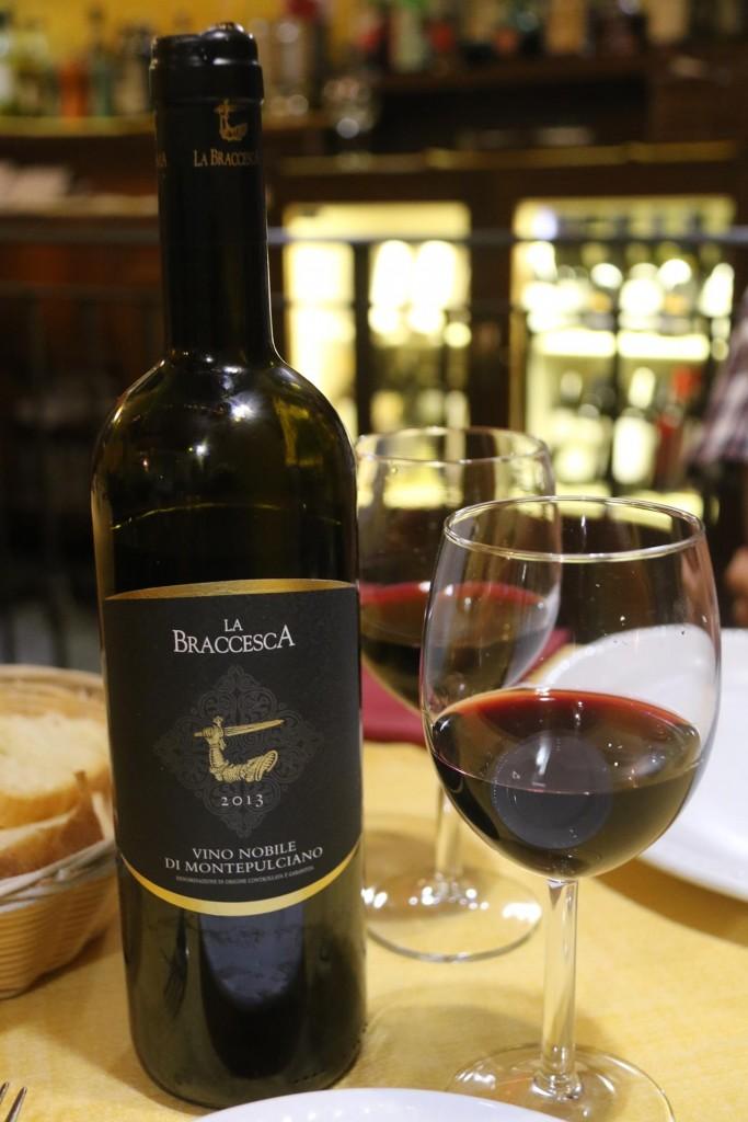 Ric orders a pleasant Montipulciano vino rosso