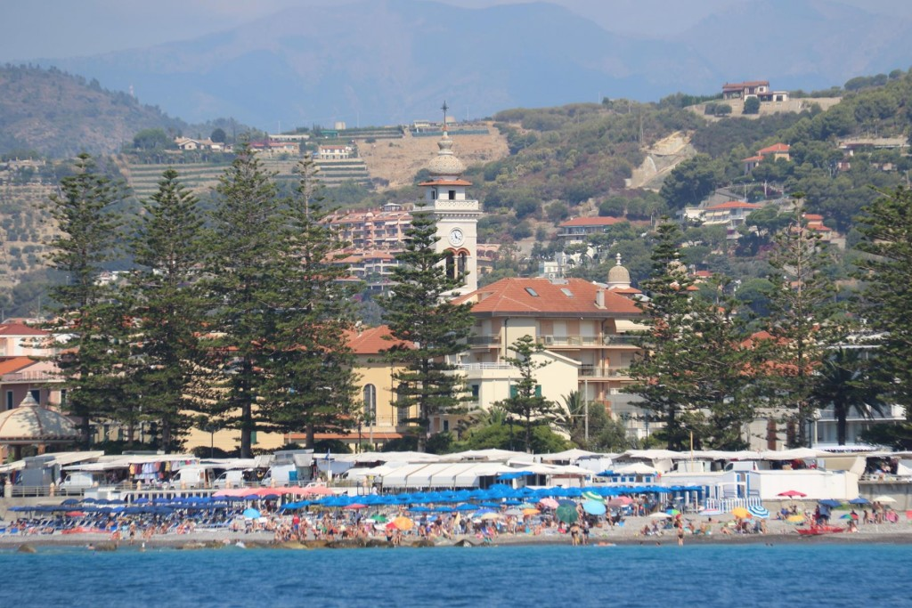 A short distance down the coast from San Remo, Monastero Delle Carmelitane Scalze can be seen from the water behind the busy beach