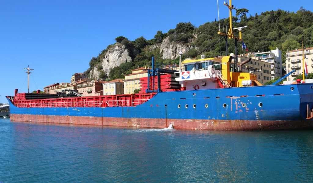 The rock and dirt excavated from the tunnel was transported by conveyor belts to this large barge nearby in the port