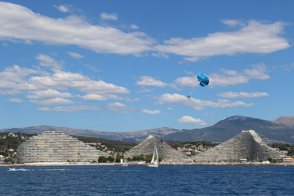 A number of unusual pyramid shaped apartment blocks can be seen from the distance in Baie des Anges