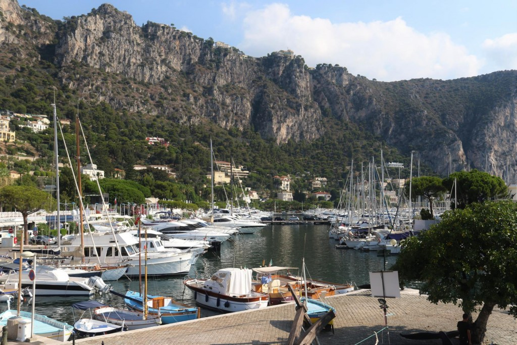 The marina is sheltered by the cliffs of the surrounding mountain ridge