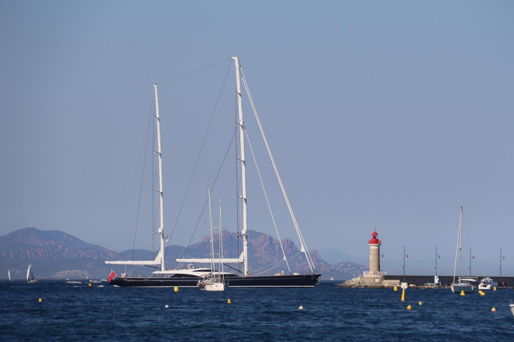 A very large and sleek yacht arrives to take a berth in the famous port