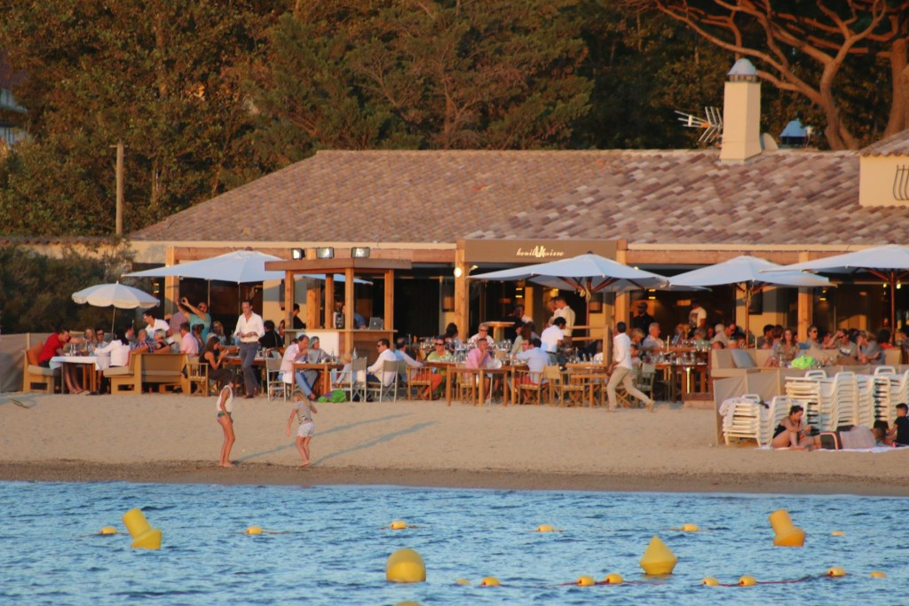 Once the sun lounges were stacked aside, the tables of the restaurant spilled out on to the beach