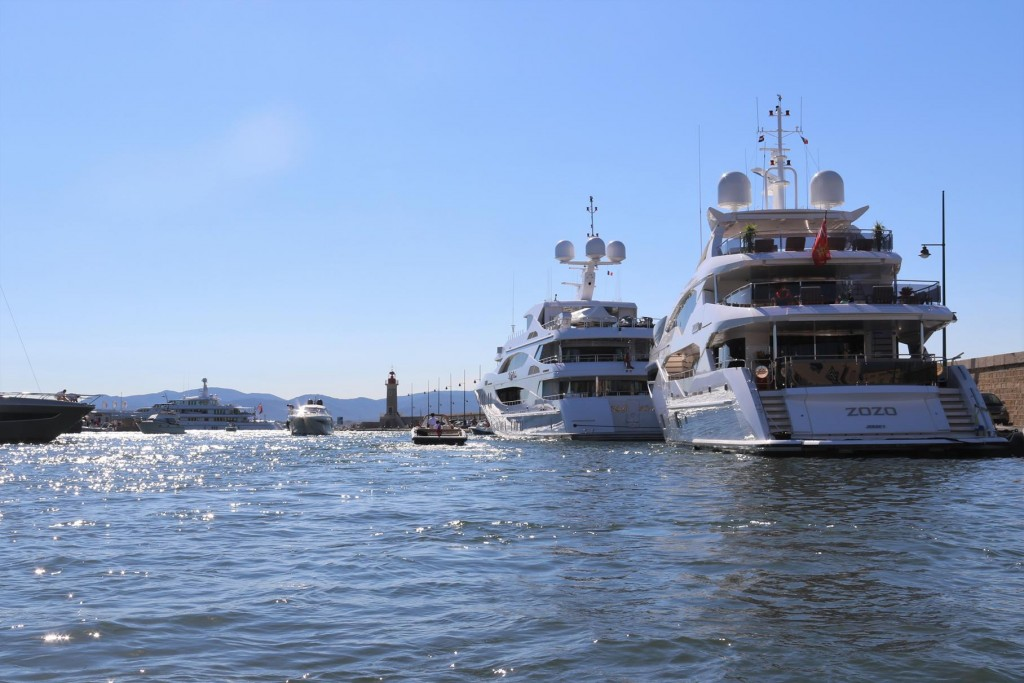As we depart a few large motor yachts have arrived