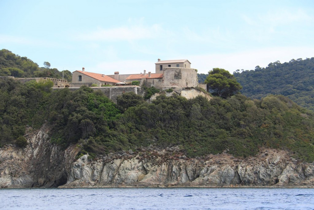 A fortified chateau is conspicuous on the north side of the small harbour