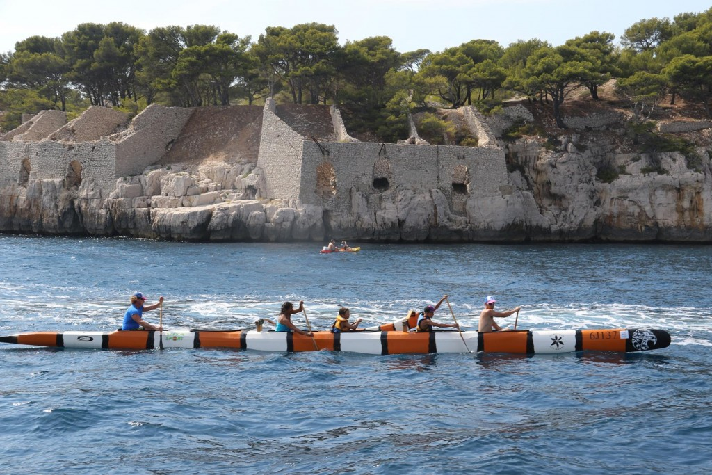 As we leave Port Miou we see ancient dwellings carved into the limestone.....and rowers