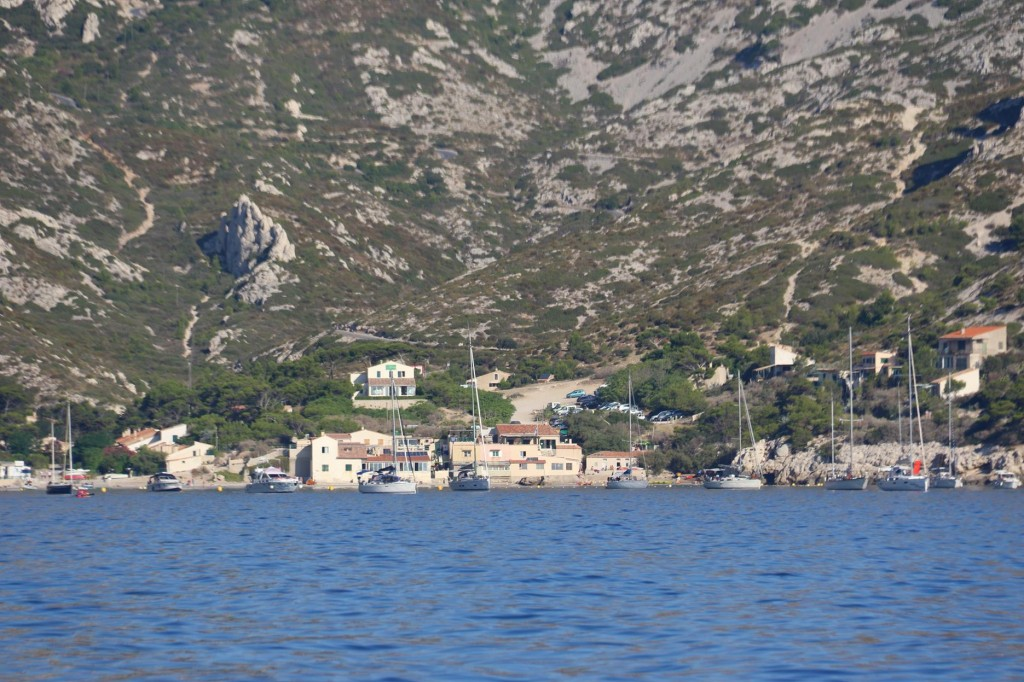 A small cluster of houses and a couple of restaurants lie at the head of the bay