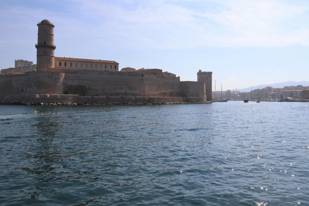 As we near the port , the 13th century Fort of St Jean is on our port side