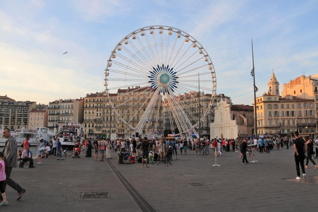 The ferris wheel at the head of the harbour is very popular in Marseille