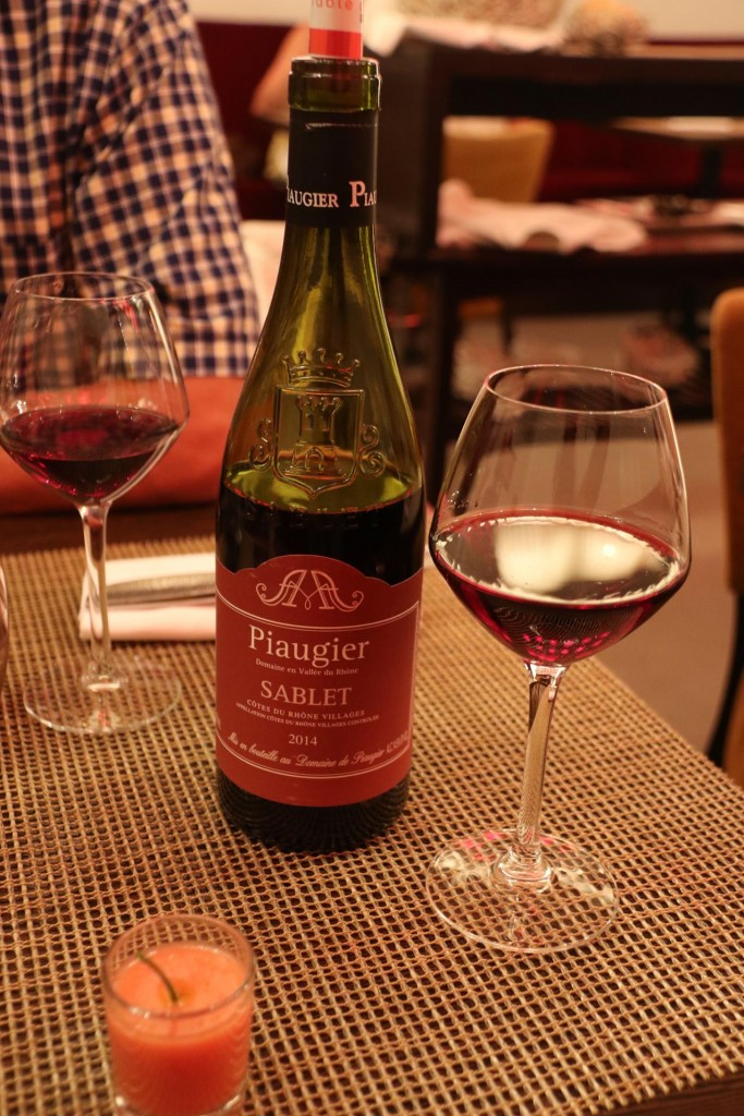 Ric orders a light French red to match the restaurant's set  menu