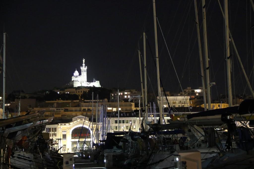 Notre Dame de la Garde Basilica glowing on the hillside across the harbour