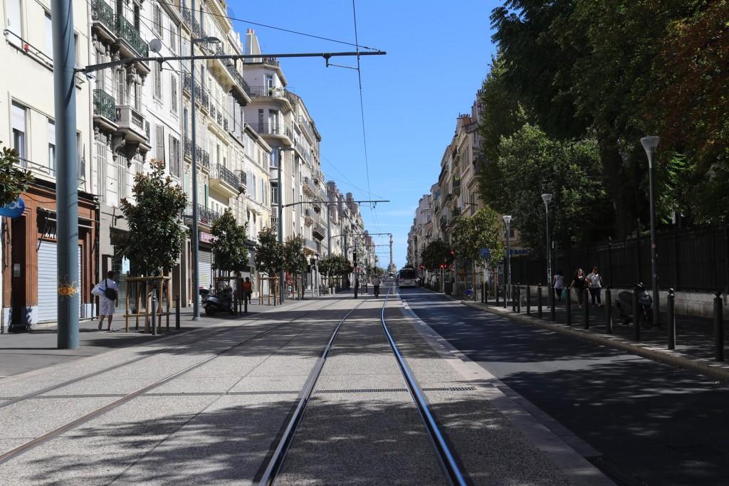 We ride along the tram tracks of Rue de Rome