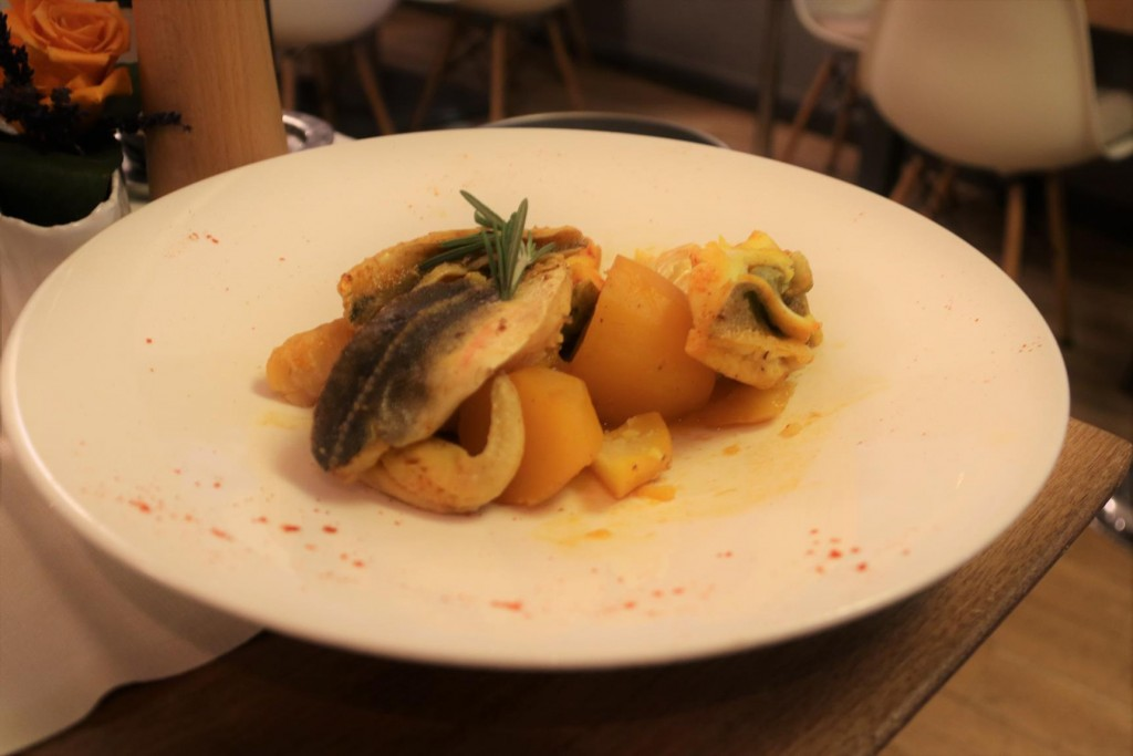Several different kinds of fish and potoato accompany the bouillabaisse broth