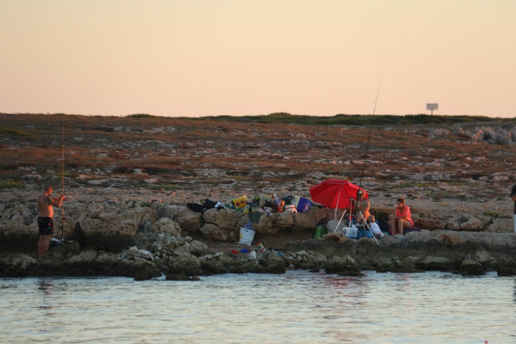 The locals look like they enjoy fishing from the rocks until quite late in the bay, Anse des Laurons