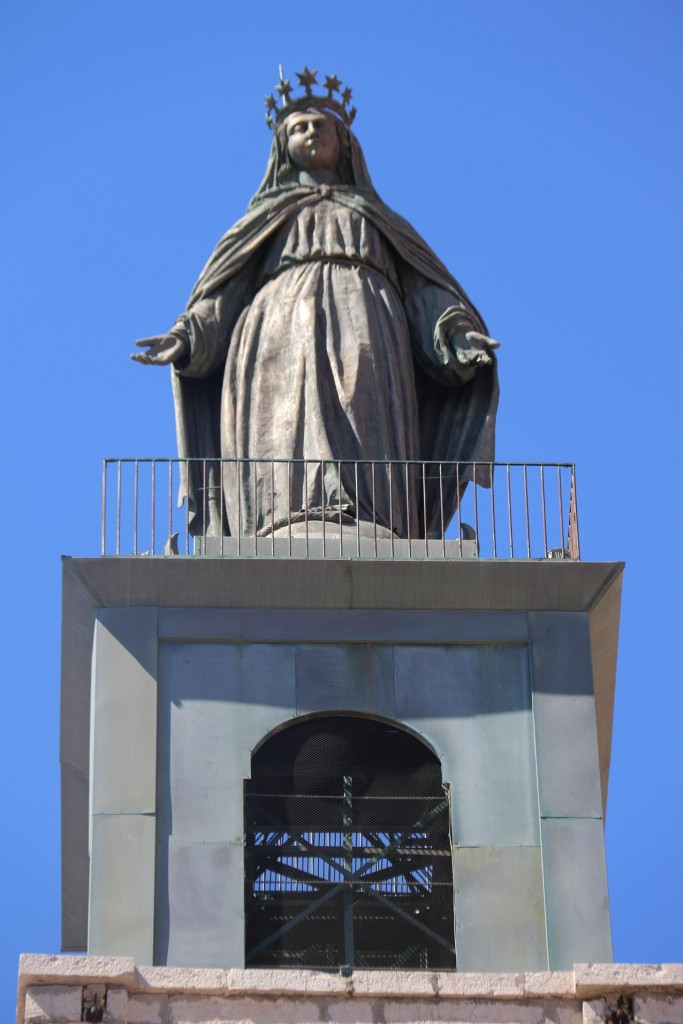 The copper statue of the Virgin Mary was added in 1869 which dramatically increased the height of the church which can be seen clearly overlooking the port
