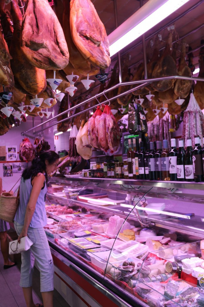 Many legs of the Spanish Jamón serrano are proudly displayed in the local delicatessen