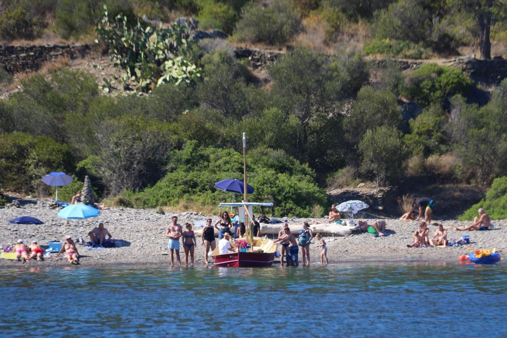 We were intrigued when we saw a small boat head to the beach which attracted numerous of the beach goers