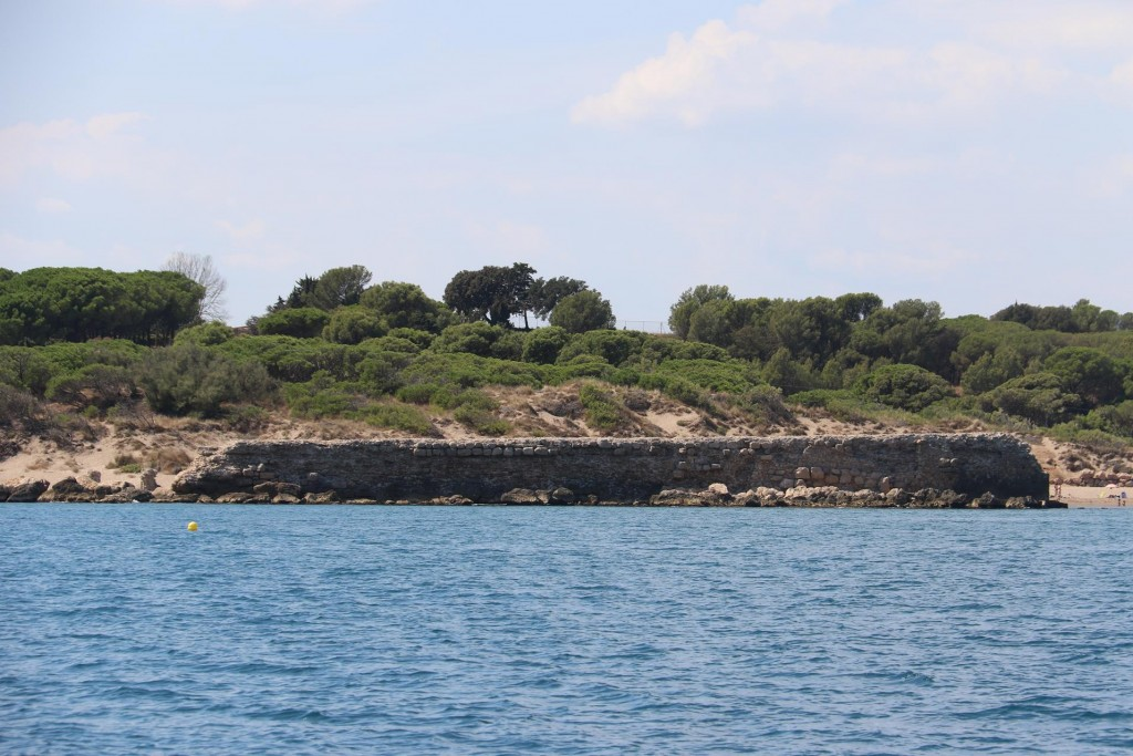 Ancient remains of the old Greek port which  can be clearly seen in the bay which was firstly used by traders as far back as the 6th Century BC
