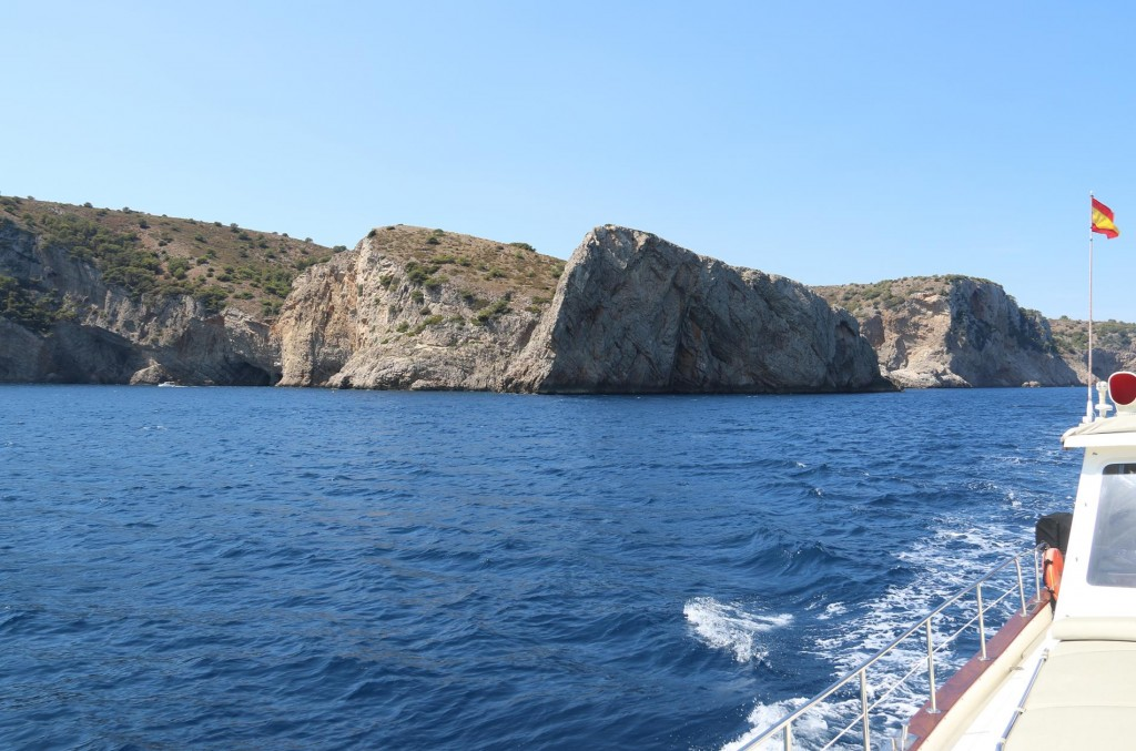 We pass by Cap del Castell where small boats can pass through an archway of the headland