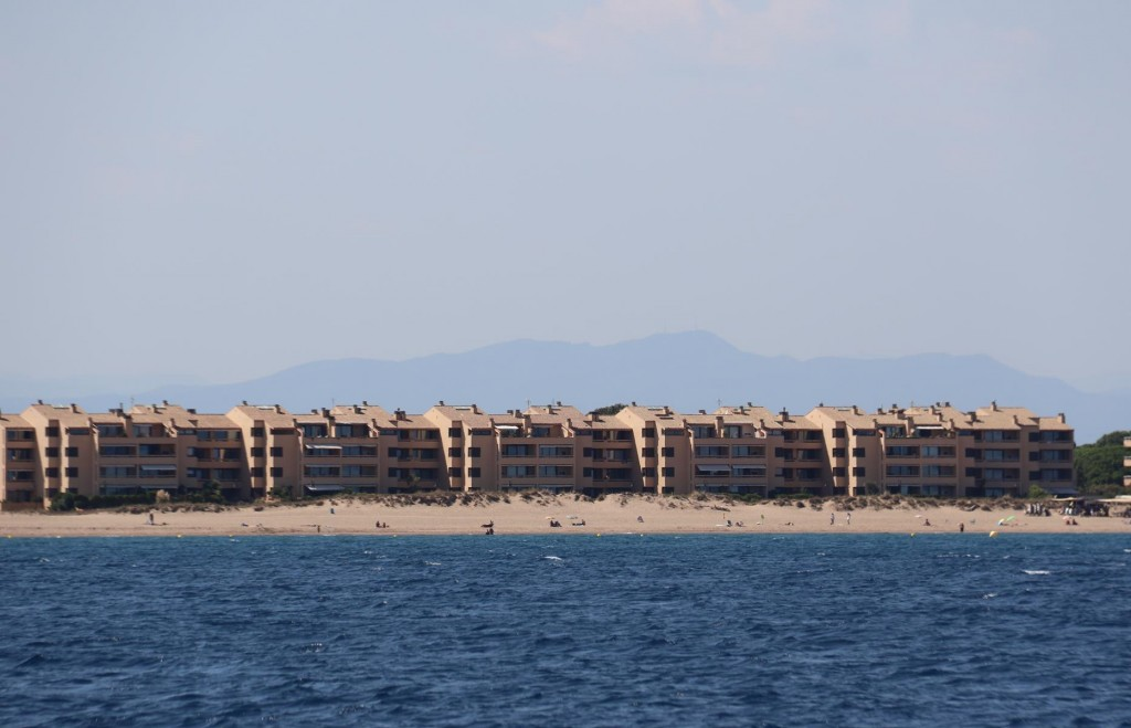 Heading south from L'Estartit is a continual sandy beach framed by many holiday complexes