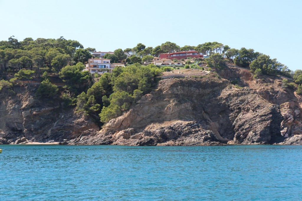 Nearby perched on high cliffs are exclusive homes overlooking the sea