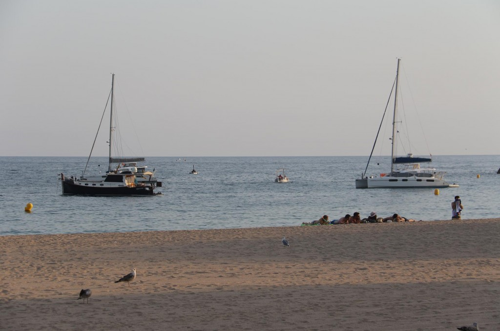 Tangaroa comfortably moored off the beach in Blanes