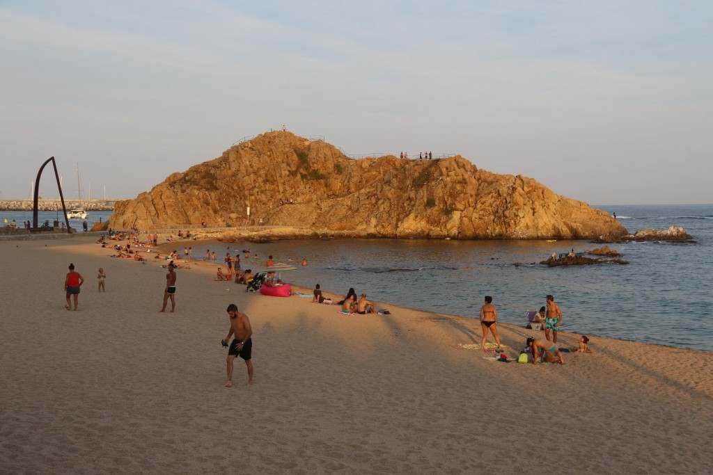 Sa Palomera the rock formation off the beach is a popular spot to climb and enjoy the view over the beach and town