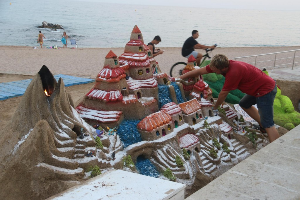 Nearby an artist creates and amazing sand sculpture!!