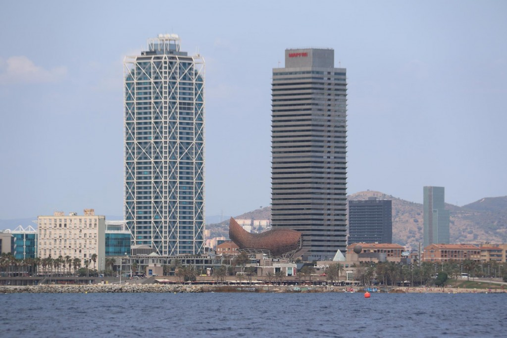Hotel Arts and the Mapfre Tower are the tallest buildings in Barcelona with a large fish sculpture in the foreground