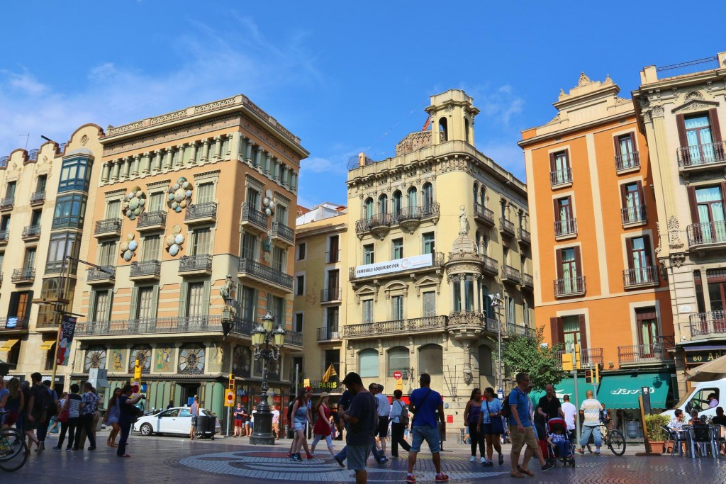 From Placa de Catalunya heading south we follow the well know La Rambla, a very long tree lined promenade that links the square to the port